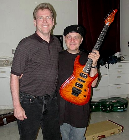 My custom guitar, and Phil Keaggy - This photo is of Phil Keaggy's concert in 2002, where he played my custom Zion guitar, shown here. On the left is the guitar's designer, Ken Hoover, prior owner of Zion Guitars. Ken now works at another company called Moriah Guitars. Check out both sites at zionguitars.com and moriahguitars.com