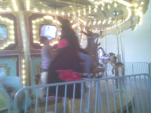 bad pic of Itachi on the carosel - another day at the Mall for the Akatsuki