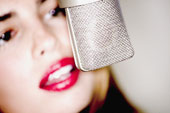 voice lending - This lady looks confident while speaking on the microphone