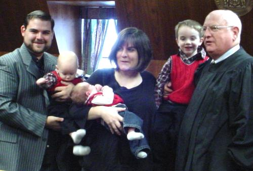 The Adoption Ceremony for Malachi - My son Jon and his wife Jen have adopted a little boy. They named him Malachi. From the left are Jon, Malachi, Keaton, Jen, Liam and Judge Henriksen of Delaware Family Court, Georgetown Delaware.