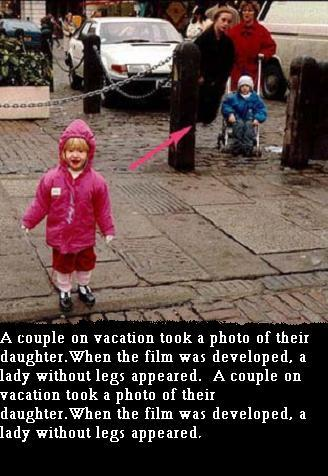 ghost - A couple took a photograph of their child but a women without legs is standing behind that child. It can be seen in photo