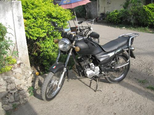 motorcycle - motorcycle of neighbor parked outside our gate