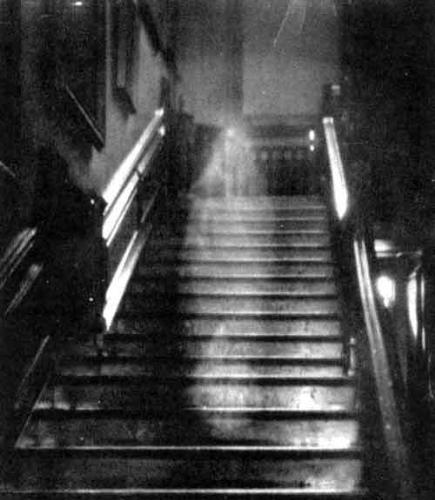 ghosts - A picture of a ghost walking down the stairs, all white and stuff. it's of a lady.