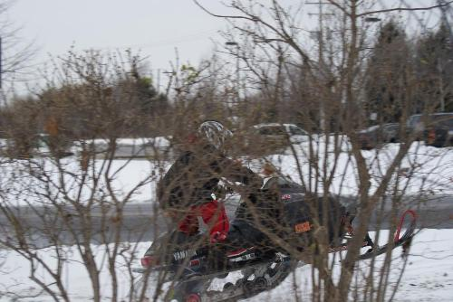 Playing in the snow - Here is a picture of me doing a wheelie on a snowmobile