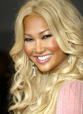 Kimora Lee - Designer and mogul Kimora Lee Simmonds with blonde hair and a tan.