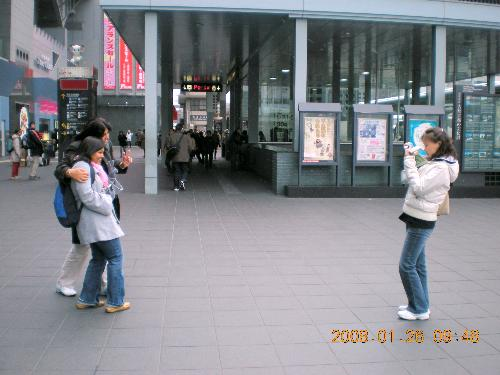 Candid Photo - A candid photo outside Kyoto train station during a sightseeing trip.