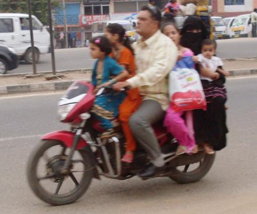 Motorcycle ride - A family of six members enjoying on a single motorcycle.