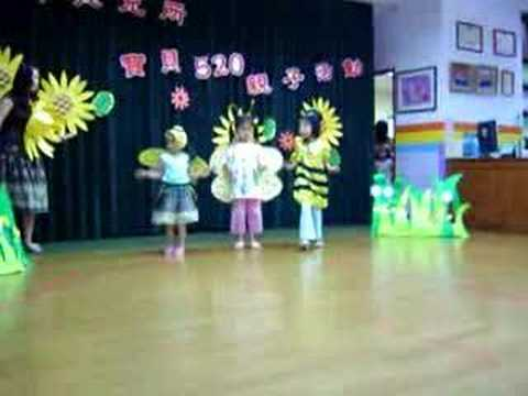 Kindergarten Show - A group of small children performing in a spring show.