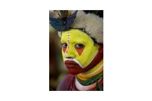 Face Painting of a Huli Man from Papua New Guinea - This is photo of a Huli Tribesman from the highlands of Papua New Guinea. He paints his face and has human hair wig on his head for a traditional dance.