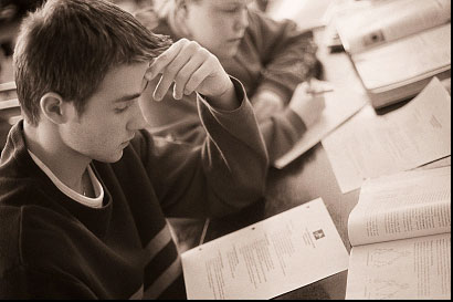 Student  - The picture shows a student who study a lot in order to pass the examination and also for the sake of learning a certain subject matter even to the point of sacrificing his other wants.