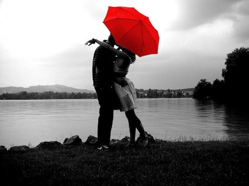 Love - Love.. couple kissing under the red umbrella.