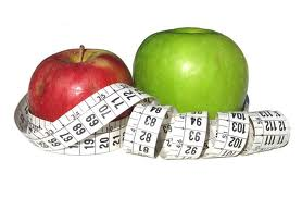 Tape Measure and Apple - Apple food that is great when you are dieting and a Tape Measure to check your improvement.