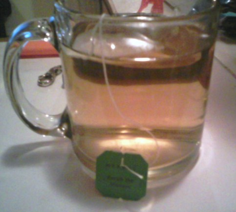 """Cup of tea - This is my chamomile tea, altho message not focused it reasd """" Enrich the moment""""."""