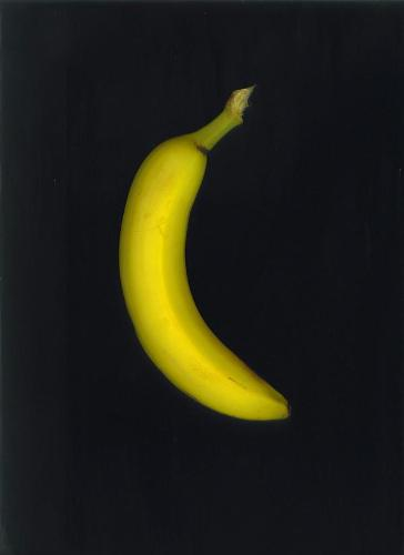 Banana - Yellow banana, black background.