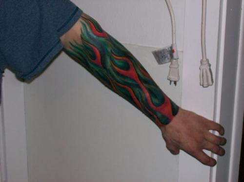 Nephew's Tattoo - My nephews very colored and loud tattoo. I hate it!