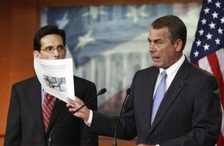 House Speaker John Boehner and House Majority Lead - House Speaker John Boehner of Ohio, right, accompanied by House Majority Leader Eric Cantor of Va., holds a copy of a proposal to repeal the Health Care Bill, Thursday, Jan. 6, 2011, during news conference on Capitol Hill in Washington. (AP Photo/Alex Brandon)