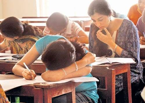 examination hall - examination hall showing students writing papers