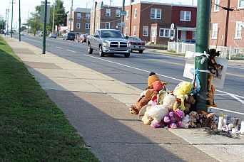 Memorial - teddy bears left for the mourning for someboy who lost his life due to gun violence.