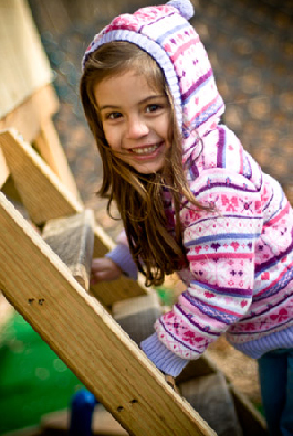 Valya on playset - In a photo shoot where she is on a play set. She will soon appear in ads for a local business that sells sheds, garages and children's play sets.