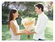 Declaring Love To Your Love One - A man is giving flower to the girl and tell her that he love her.
