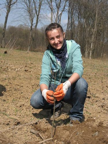 Let's plant with a smile - Planting trees should be fun, not only tiresome, so let's smile when we plant, how about that ? :) At Snagov, near Bucharest, this april, in Romania.