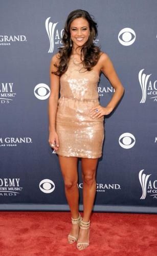Jana Kramer - I don't know who she is but she was at the 2011 ACM Music Awards! I like the dress but you can still her feet are not tanned and they stand out from the rest of her!