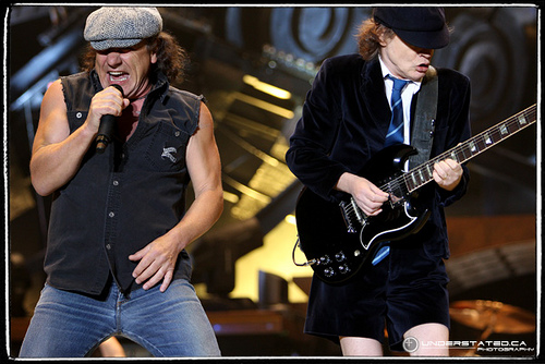 ac/dc - this is the pic of AC/DC performing live.. the lead singer and the lead guitarist are in the pic... they are amazing.. love the songs they make.. amazing band..
