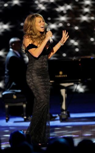 Mariah Carey - this is a pic of Mariah carey performing live in a beautiful dress.. amazing songs..