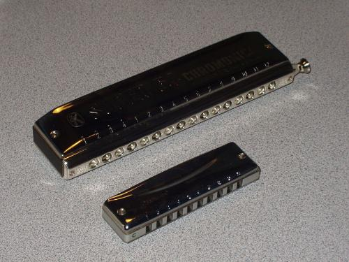 Harmonica's - Two types of Harmonica's. Sometimes refered to as a 'Mounth Organ'!