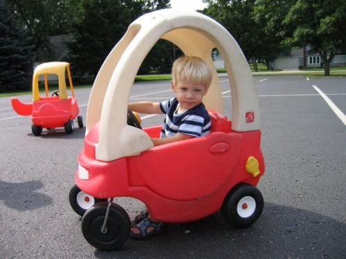 kiddy in a car - An image of a kiddy in a car for this category