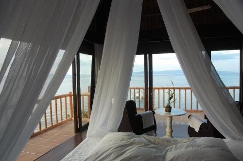 Rooms - Beach front room,made of native bamboo. Love it. So love the interior.