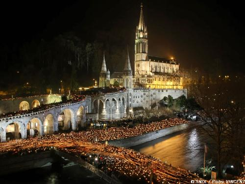 The torchlight procession at lourdes. - Everyone carries torches and forms a procession in the grounds of the basilica. So magical and beautiful. I'll hold that memory forever.