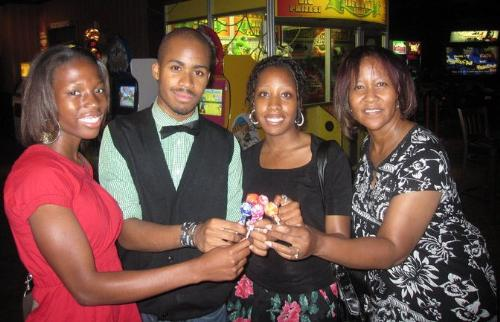 My 25th b-day - This is a pic of me, my mom, brother, and his girlfriend at 'the boneyard' restaurant on my b-day