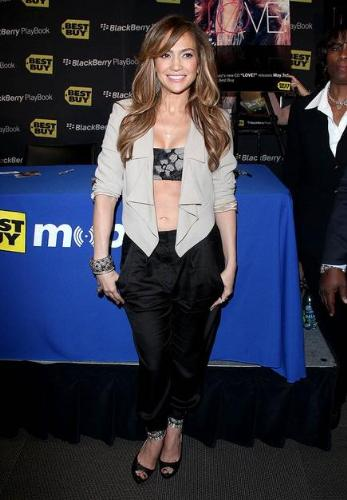Jennifer Lopaz - At a promotiion on her new cd release JLO wore this crazy outfit! It looks like she is wearing just a bra under her jacket and she is wearing balloon pants! One of the few fashion mistakes I have seen her made!