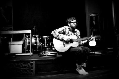 Dallas Green - Dallas Green playing the guitar.