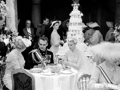 Prince Rainer and Princess Grace - This was the wedding cake Prince Rainer and Grace Kelly had on their wedding day. The topper on the cake moved around and played a song! There was also 2 doves in a cage built in the cake and the doves were released when the cake was cut!