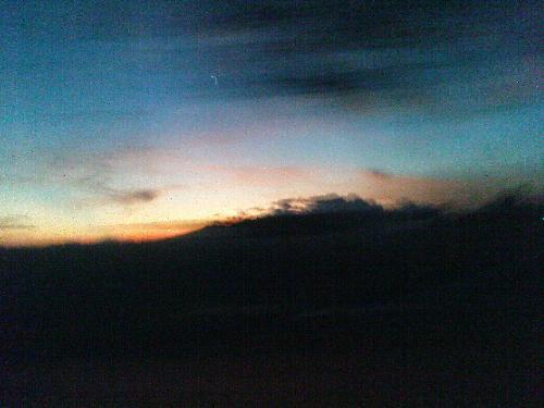 Sunrise while Traveling - I personally take this photo while i'm in a car. I just amazed the beautiful sunrise..:)