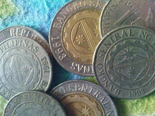 Philippine Money - One peso and 10 pesos coins.
