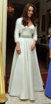 Duchess of Cambridge - The new duchess the night of her wedding in a very elegent strapless white gown with a short sweater to a dinner for the couple.