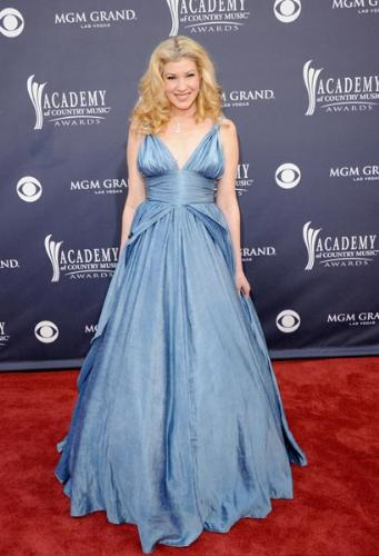 Emily West - This newcomer to country music was at last years CMA Award Show. Not a bad dress.