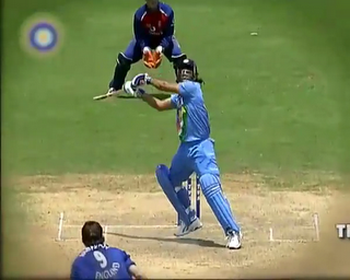 Dhoni's Helicopter - This is a picture which denotes that happpens after the helicopter shot with lot of energy and I feel he might have taken years and years of practice to do that.