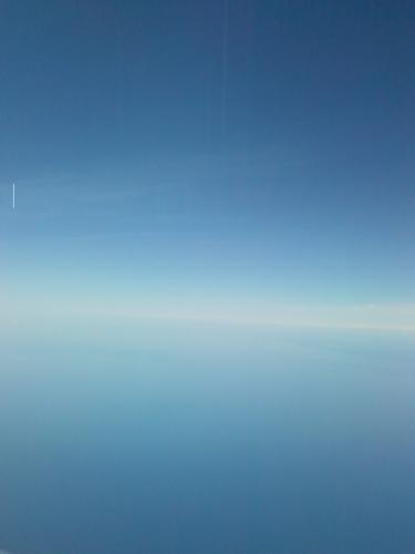 When Air Meets Water - This is another photo I took while in flight (with airplane mode turned on). We were over a large lake, I believe, and the sky was crysal blue. It was beautiful, and it felt like we were on the edge of the earth.