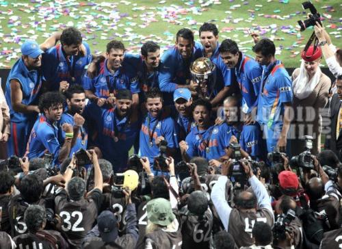 India With 2011 World Cup - After a dramatic final between India and Srilanka.India won the game and India won their second World Cup title.And it was only the third time in World Cup history a team chasing has won.