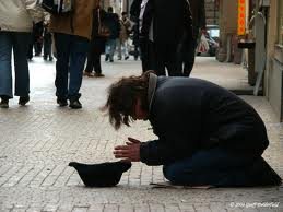 tramp - begging in the street.