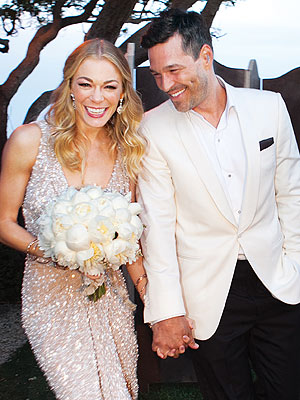 Leeann Rimes and her new husband - LeeAnn Rimes married her lover Eddie Cibrian. Rimes has said she doesn't feel guilty or ashamed for bresking up her marriage or Eddie's! I am sure this marriage will never last!