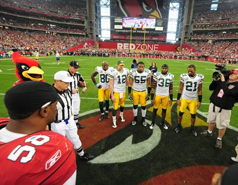 The team Captains - The Packers captians on the field with the cardinals captians before the kick off in January 2010 playoff game.