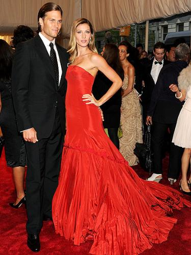 Tom and Gisele - Tom Brady and his lovely wife Gisele. I wish Tom would talk his wife into letting him get his hair cut! It is not his style! it is stupid looking!