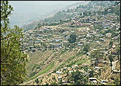 Almora : Uttaranchal - This photo is of Almora, This charming hill resort was the flourishing capital of the chand dynasty. The region was earlier under the reigns of the katyuri king baichaldeo, who donated this area to Gujrathi brahmin Shri Chand Tiwari. In 1560 the capital of the chand destiny was shifted to Almora (From Champawat) by Kalyan chand. The beautiful town is set on a 6 kms long horse shaddle shaped ridge. It affords breadth taking views of the snowy summits of Himayalayas and is an excellent place for a peaceful holiday.