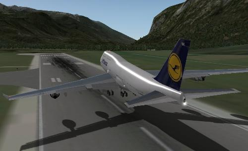 B747 Liftoff - A Boeing 747 leaving the ground in X-Plane 9. Flaps can be seen on the trailing edge of the wings.