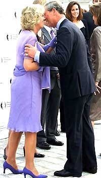 A kiss - Here is a photo of Prince Charles kissing his wife camilla,Duchess of Cornwell,in public.